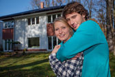 Couple in front of the new house — Stock Photo