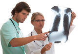 Pulmonologist and surgeon watching x-ray — Stock Photo