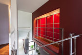 Red lighted wall in modern house — Stock Photo