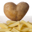 Heart shaped potatoe — Stock Photo