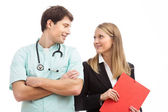 Doctor and finance specialist in hospital — Stock Photo