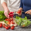 Preparing a salad with fresh vegetables — Stockfoto