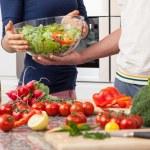Boyfriend helping his girfriend in kitchen — Stock Photo