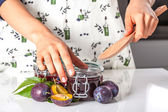 Filling the jar with a jam — Foto Stock