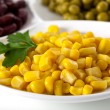 Yellow corn on white plate — Stock Photo