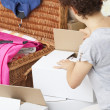 Cardboard box unpacking — Stock Photo