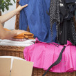 Stock Photo: Clothing pieces packing