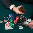 Gambler with alcohol and handcuffs — Stock Photo #36668727