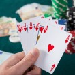 Hand holding royal flush — Stock Photo