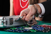 Suitcase with money on casino table — Stock Photo