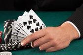 Man hand holding poker cards — Stock fotografie