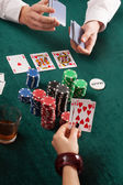 Cards, colorful poker chips and alcohol — Stock Photo