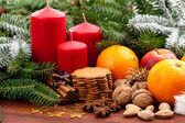 Candles, fruits, cookies and nuts — Stock Photo