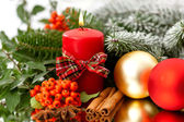 Candle, cinnamon and spruce — Stock Photo