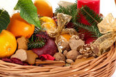 Fruits, nuts and gingerbreads in basket — Stock Photo