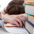 Exhausted student behind a books — Stock Photo