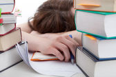 Exhausted student behind a books — Foto de Stock