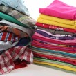 Stock Photo: Pile of messy and ironed clothes