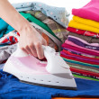 Woman ironing blue T-shirt — Stock Photo