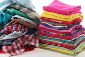 Pile of messy and ironed clothes — Stock Photo