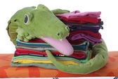 Child's laundry on ironing board — Stock Photo