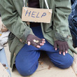 Poor homeless beggar — Stock Photo