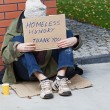 Young homeless male begging for help — Stock Photo