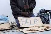 Homeless alcoholic holding a bottle — Stock Photo