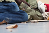 Homeless lying on the ground — Stock Photo