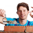 Happy man building a wall — Stock Photo #37049579
