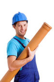 Blue collar worker with pipe — Stock Photo