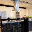 Urban apartment - Black counter in kitchen — Stock Photo