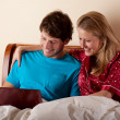Couple watching the movie in bed — Stock Photo