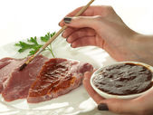 Marinating meat — Stock Photo