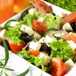 Tasteful garnished greek salad — Stock Photo #37114673