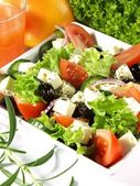 Tasteful garnished greek salad — Stock Photo