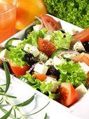 Tasteful garnished greek salad — Stock Photo