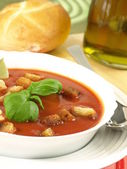 Tomato soup with croutons and bread — Stock Photo