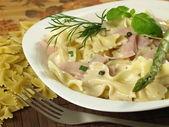 Farfalle pasta with ham — Stock Photo