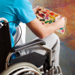 Painter in a wheelchair — Stock Photo