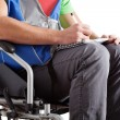 Disabled student writing the notes — Stock Photo