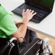 Young disabled employee working — Stock Photo #37143959