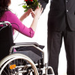 Receiving roses on wheelchair — Stock Photo