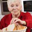 Grandma at kitchen — Stock Photo #37147237
