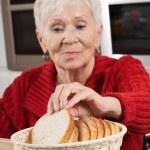 Grandma at kitchen — Stock Photo