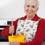 Постер, плакат: Grandma baking cake
