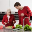 Grandma and grandson cooking — Photo