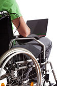Student with laptop on wheelchair — Stock Photo