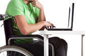 Disabled by desk — Stok fotoğraf