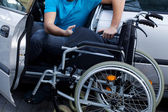 Disabled driver consisting his wheelchair — Stock Photo